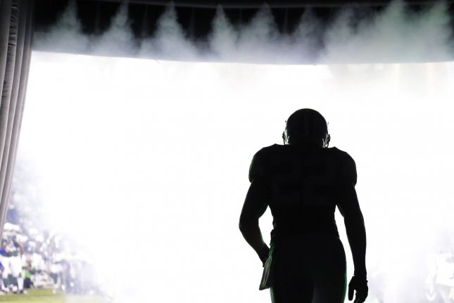 Former New York Jets running back Matt Forte walks out to the field before the game against the New England Patriots in Week 12 of the NFL season on November 27 at MetLife Stadium in East Rutherford, N.J. Photo by John Angelillo/UPI