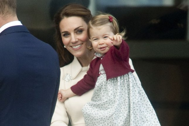 Princess Charlotte (R), pictured with Kate Middleton, turned three years old on Wednesday. File Photo by Heinz Ruckemann/UPI
