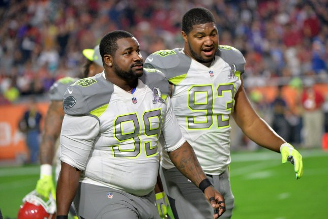 Former Buffalo Bills and current Jacksonville Jaguars defensive tackle Marcell Dareus (99) and ex-Arizona Cardinals and current Jaguars defensive end Calais Campbell (93) leave the field together during the Pro Bowl on January 24, 2015 at University of Phoenix Stadium in Glendale, Arizona. File photo by Kevin Dietsch/UPI