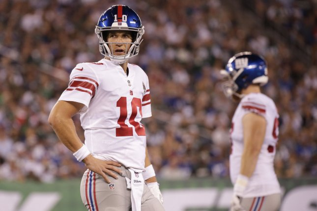 New York Giants quarterback Eli Manning (10) stands on the field in the  second quarter of a preseason game against the New York Jets on August 24 7946a0b40