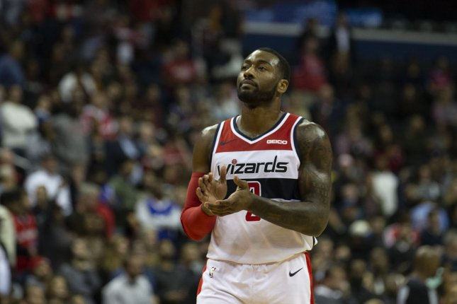 Washington Wizards guard John Wall (2) claps after a big play. Photo by Alex Edelman/UPI