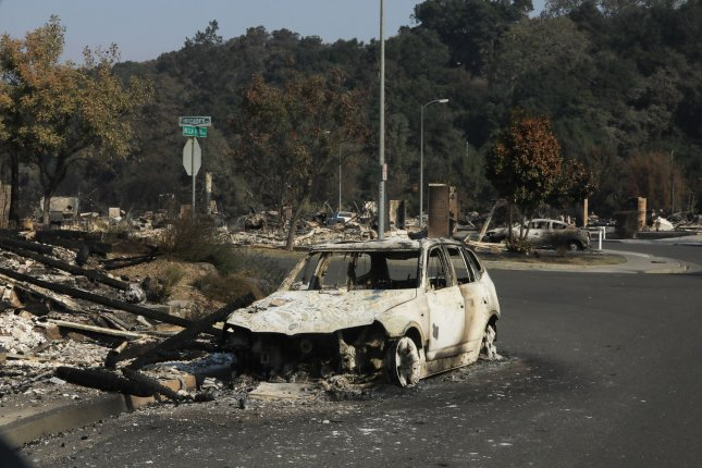 Cars sit in front of burned houses on Bella Vista Way in Santa Rosa, Calif., on October 12, 2017. Cal Fire determined Thursday that a private electrical system was responsible for the Tubbs Fire that killed 22 people. File Photo by Khaled Sayed/UPI