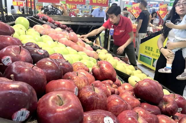 Chinese consumers shop for apples at a Walmart in downtown Beijing in 2018. India was the second-leading importer for American apples before trade tensions erupted with the United States last spring. File photo by Stephen Shaver/UPI
