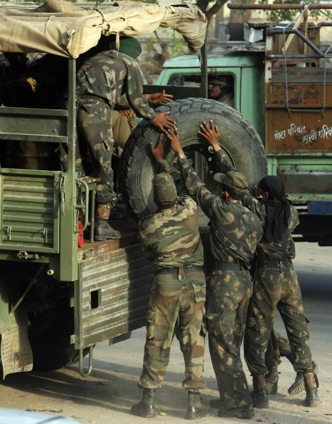 Indian soldiers load a tire into their truck before heading to the sensitive areas at Dausa in India's desert state of Rajasthan. (UPI Photo)