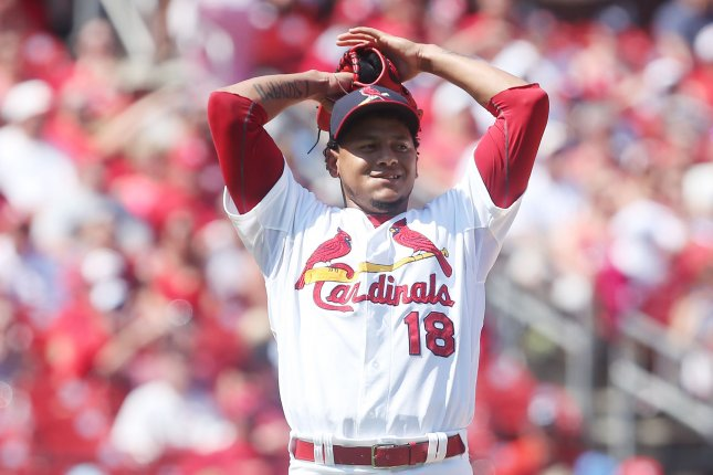 St. Louis Cardinals starting pitcher Carlos Martinez can only watch as Miami Marlins Derek Dietrich jits a three RBI triple in the fifth inning at Busch Stadium in St. Louis on August 16, 2015. Photo by Bill Greenblatt/UPI