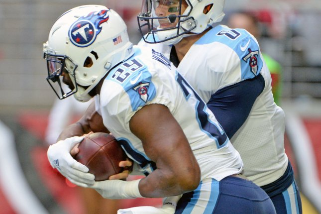 Tennessee Titans' quarterback Marcus Mariota (R) fakes a hand off to DeMarco Murray in the first quarter against the Arizona Cardinals at University of Phoenix Stadium in Glendale, Arizona December 10, 2017. File photo by Art Foxall/UPI