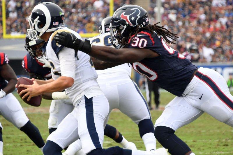 Houston Texans defender Jadeveon Clowney (R) sacks Los Angeles Rams quarterback Jared Goff (L) on November 12, 2017 at the LA Coliseum in Los Angeles. Photo by Jon SooHoo/UPI