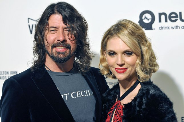 Dave Grohl (L), pictured with Jordyn Blum, rescheduled two concerts in Canada due to illness. File Photo by Christine Chew/UPI