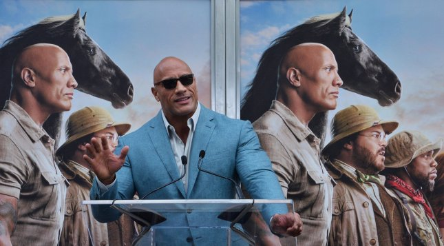 Actor Dwayne Johnson will star in and produce an NBC comedy series based on his younger years. Photo by Jim Ruymen/UPI