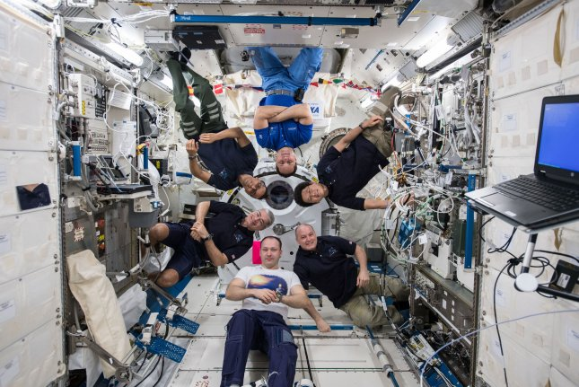 The six-member Expedition 54 crew poses for a lighthearted crew portrait inside the Japanese Kibo laboratory module on the International Space Station in 2018. Photo by NASA/UPI