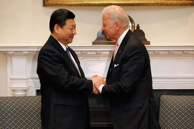 Joe Biden and Xi Jinping, who then were both vice presidents of their nations, shake hands during a meeting in the Roosevelt Room of the White House on February 14, 2012. File Photo by Chip Somodevilla/UPI/Pool