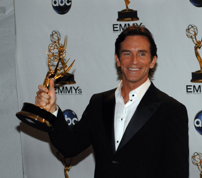 Jeff Probst holds his Emmy for outstanding host for a reality or reality-competition program for his work on 'Survivor,' backstage at the 60th Primetime Emmy Awards at the Nokia Center in Los Angeles on September 21, 2008. (UPI Photo/Scott Harms)