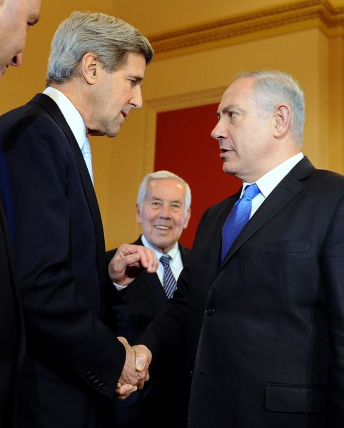 Sen. John Kerry, D-Mass., shakes hands with Israeli Prime Minister Benjamin Netanyahu as Sen. Richard Lugar, R-Ind., looks on during a photo opportunity on Capitol Hill in Washington, March 23, 2010. UPI/Roger L. Wollenberg