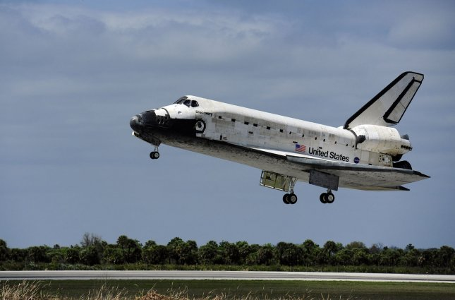 NASA's Space Shuttle Discovery approaches Runway 15 at the Shuttle Landing Facility for an on time landing at 11:57 AM at the Kennedy Space Center on March 9, 2011. Discovery's 39th and final flight ends with the successful completion of a fourteen day mission, STS 133, to the International Space Station. Discovery and her crew delivered supplies and installed the Multipurpose Logistics Module and the Express Logistics Carrier #4, completing construction of the orbiting station. UPI/Joe Marino-Bill Cantrell
