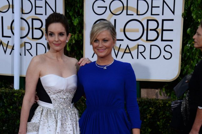 Tina Fey (L) and Amy Poehler attends the 72nd annual Golden Globe Awards at the Beverly Hilton Hotel in Beverly Hills, California on January 11, 2015. File Photo by Jim Ruymen/UPI