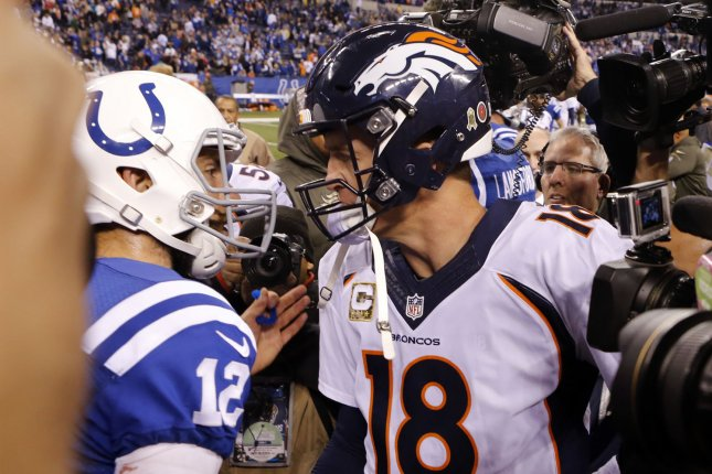 Indianapolis Colts quarterback Andrew Luck (12) shakes hands with Denver Broncos quarterback Peyton Manning (18) after defeating the Broncos 24-21 at Lucas Oil Stadium in Indianapolis, Indiana, November 8, 2015. Photo by John Sommers II/UPI