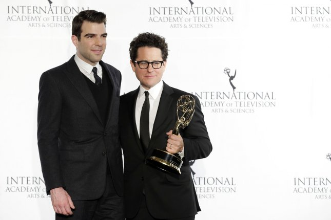 Star Trek collaborators Zachary Quinto and J.J. Abrams hold an International Emmy in the press room at the 41st International Emmy Awards in New York City on November 25, 2013. File Photo by John Angelillo/UPI
