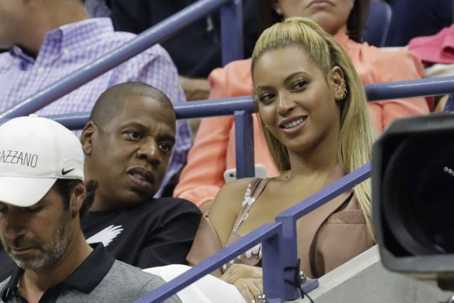 Beyoncé (R) and Jay Z watch the U.S. Open Tennis Championships on September 1, 2016. File Photo by John Angelillo/UPI