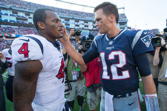New England Patriots quarterback Tom Brady (12) gives Houston Texans quarterback Deshaun Watson (4) a pat on the cheek after their game Sunday at Gillette Stadium in Foxborough, Mass. Photo by Matthew Healey/ UPI