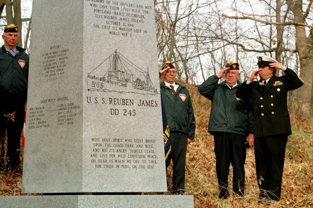 Retired Navy Chief Boatswain Stephen Heald of Georgetown, Maine, (R) blows the boatswains call during a cermony in Portland, Maine on November 14, 1998, at the just-installed monument to honor the men that died on the first United States warship sunk in World War II, the destroyer USS Reuben James. A German U-boat torpedoed the destroyer on October 31, 1941. File Photo by Lee K. Marriner/UPI