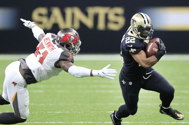New Orleans Saints running back Mark Ingram (22) picks up short yardage before Tampa Bay Buccaneers middle linebacker Kendell Beckwith (51) can make the stop in the third quarter on November 5, 2017 at the Mercedes-Benz Superdome in New Orleans. Photo by AJ Sisco/UPI