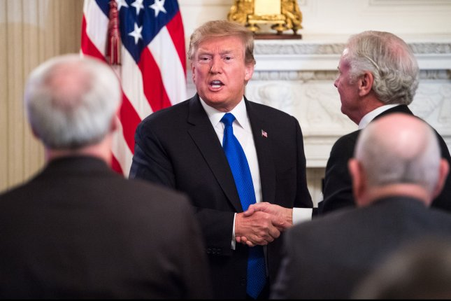 President Donald Trump shakes hands with governors after addressing the 2019 White House Business Session at the White House Monday Photo by Kevin Dietsch/UPI