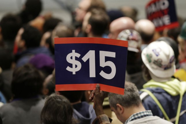 The House bill would gradually hike the federal minimum wage to $15 within six years. File Photo by John Angelillo/UPI