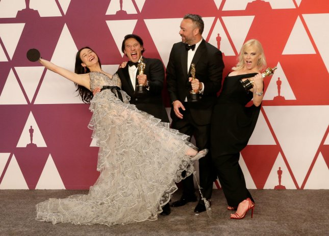 Producers Elizabeth Chai Vasarhelyi, Jimmy Chin, Evan Hayes and Shannon Dill, winners of the award for Best Documentary Feature for Free Solo, appear backstage at the 91st annual Academy Awards in Los Angeles on February 24. File Photo by John Angelillo/UPI