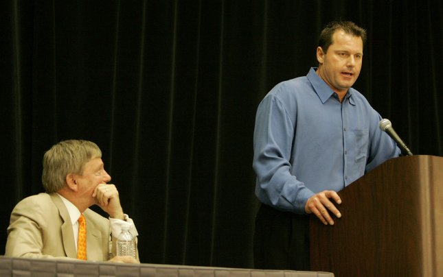 Roger Clemens answers questions from the media as his attorney Rusty Hardin (seated) listens during a press conference held at the George R. Brown convention center in Houston, Texas on January 7, 2008. (UPI Photo/Stephen O'Brien)