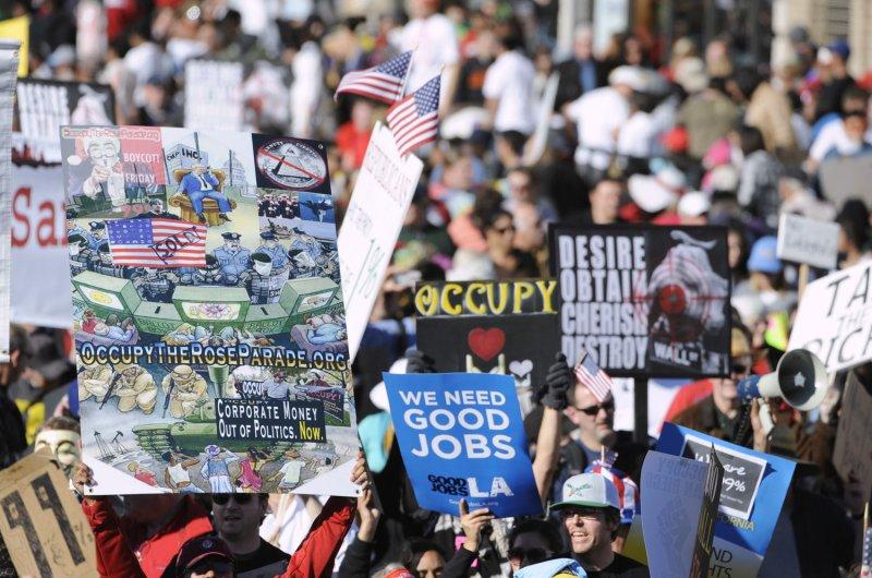 Occupy LA protestors follow the 123rd Tournament of Roses Parade held in Pasadena, California on January 2, 2012. UPI/Phil McCarten