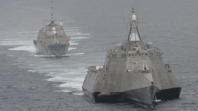 The first of class littoral combat ships USS Freedom (LCS 1), rear, and USS Independence (LCS 2) maneuver together during an exercise off the coast of Southern California, near San Diego on May 2, 2012/ .The littoral combat ship is a fast, agile, networked surface combatant designed to operate in the near-shore environment, while capable of open-ocean tasking, and win against 21st-century coastal threats such as submarines, mines, and swarming small craft. UPI/ Lt. Jan Shultis/USN.