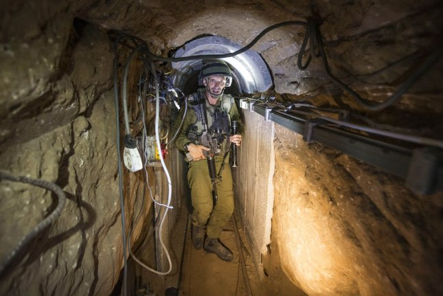 An Israeli army officer gives explanations to journalists on July 25, 2014 during an army organised tour in a tunnel said to be used by Palestinian militants for cross-border attacks. Israel launched its military offensive aiming at destroying tunnels used by militants. UPI/Jack Guez/Pool