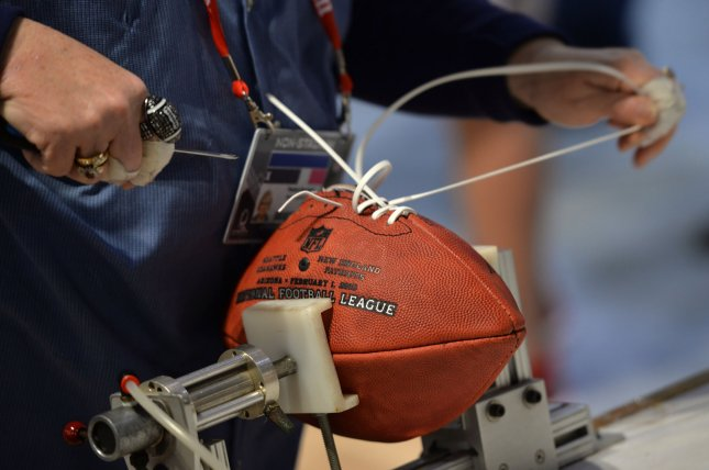 A worker hand builds a football at the NFL Experience in the run-up to Super Bowl XLIX in Phoenix. The New England Patriots will take on the Seattle Seahawks in Super Bowl XLIX on Feb. 1. Photo by Kevin Dietsch/UPI