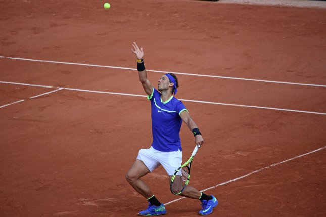 Rafael Nadal of Spain hits a serve during his French Open men's third round match against Nikoloz Basilashvili of Georgia at Roland Garros in Paris on June 2, 2017. Nadal advanced to the quarterfinals with a 6-1, 6-2, 6-2 victory against fellow Spaniard Roberto Bautista Agut. Photo by David Silpa/UPI