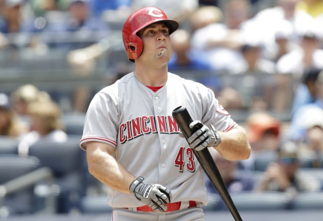 Scott Schebler and the Cincinnati Reds held off the Atlanta Braves on Saturday. Photo by John Angelillo/UPI