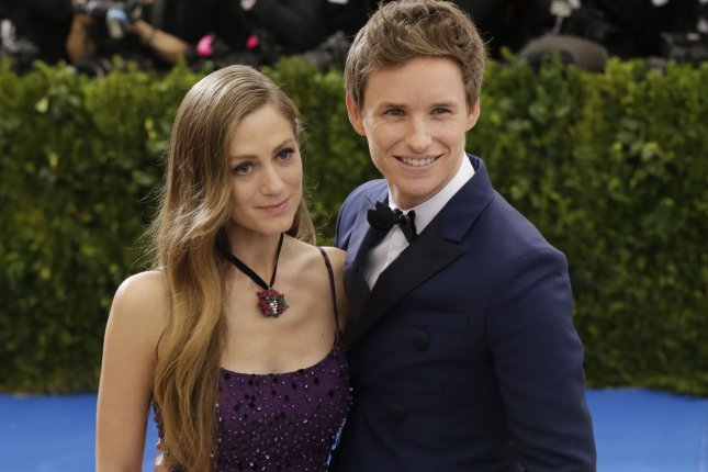 Eddie Redmayne and his wife Hannah arrive on the red carpet at the Costume Institute Benefit at The Metropolitan Museum of Art in New York City on May 1. Redmayne will be seen reading a bedtime story on the Christmas Day edition of CBeebies. File Photo by John Angelillo/UPI