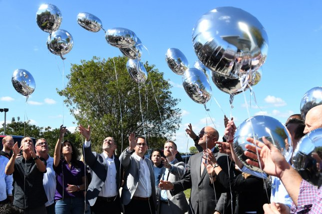 Balloons are released Thursday during a prayer vigil at Church United for the 17 people who were killed at Marjory Stoneman Douglas High School. Photo by Gary Rothstein/UPI