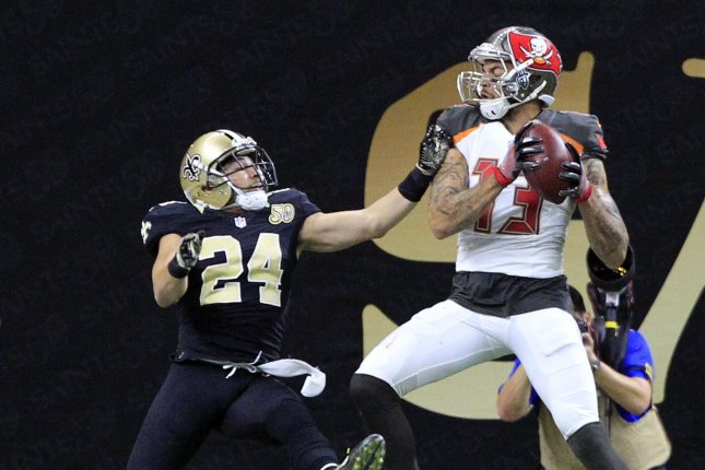 262fc51c5 Tampa Bay Buccaneers wide receiver Mike Evans (13) pulls in a 34-yard  touchdown in front of New Orleans Saints cornerback Sterling Moore (24) in  the third ...