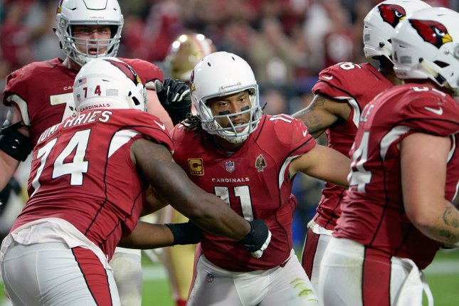 Arizona Cardinals wide receiver Larry Fitzgerald (C) celebrates scoring a touchdown in the fourth quarter of the Cardinals-San Francisco 49ers game on October 28 at State Farm Stadium in Glendale, Ariz. File Photo by Art Foxall/UPI