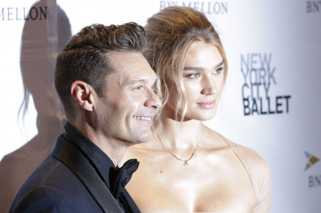 Ryan Seacrest (L) confirmed his split from Shayna Taylor after he was spotted with a new woman in Mexico. File Photo by John Angelillo/UPI