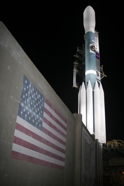 The GLAST spacecraft and Delta II rocket sit on the launch pad in the early morning at Kennedy Space Center, Florida on June 11, 2008. GLAST is a powerful space observatory that will explore the most extreme environments in the universe, search for signs of new laws of physics, what composes the mysterious dark matter, explain how black holes accelerate immense jets of material to nearly light speed, and help crack the mysteries of the staggeringly powerful explosions known as gamma-ray bursts. (UPI Photo/Carleton Bailie/NASA/United Launch Alliance)