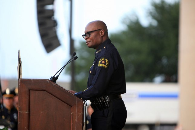 Dallas Police Department Chief David Brown takes part in a candle light vigil outside City Hall in Dallas, Texas, on Monday, July 11, 2016, after five police officers were killed in an ambush attack during a protest rally on July 7. Thursday, Brown announced he would retire next month and promised more details at a news conference on Sept. 8. File Photo by Chris McGathey/UPI
