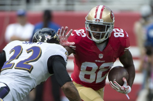San Francisco 49ers WR Torrey Smith (82) tries to hold off Baltimore Ravens Jimmy Smith (22) in the first quarter at Levi's Stadium in Santa Clara, California on October 18, 2015. Photo by Terry Schmitt/UPI