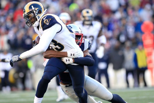 Los Angeles Rams wide receiver Brian Quick (83) is dragged down by New England Patriots defensive back Eric Rowe (25) on a six-yard reception in the third quarter at Gillette Stadium in Foxborough, Massachusetts on December 4, 2016. The Patriots defeated the Rams 26-10 and Brady became the NFL's all-time leader for wins by a quarterback for a total of 201 wins in 264 games. Photo by Matthew Healey/ UPI