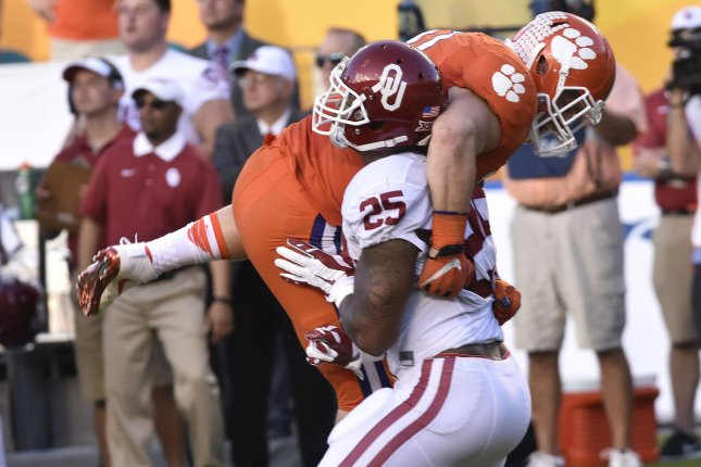 Oklahoma running back Joe Mixon (25) blocks Clemson line backer Ben Boulware (10) in the first quarter of the College Semifinal Championship Orange Bowl at Sun Life Stadium on December 31, 2015 in Miami Gardens, Florida. Mixon could be the first player taken by the Vikings in the 2017 NFL Draft after the departure of Adrian Peterson. File photo by Gary I Rothstein/UPI