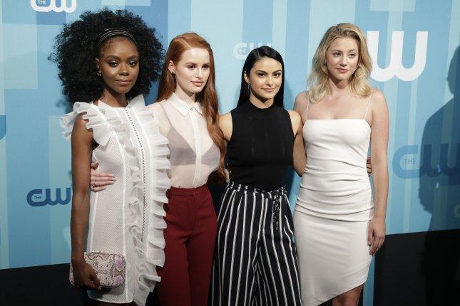 (Left to right) The cast of Riverdale Ashleigh Murray, Madelaine Petsch, Camila Mendes and Lili Reinhart arrives on the red carpet at the 2017 CW Upfront at the London Hotel on May 18. A new trailer for Season 2 of Riverdale features Archie (KJ Apa) dealing with his father (Luke Perry) being shot. File Photo by John Angelillo/UPI