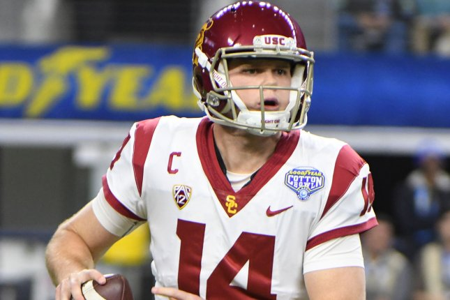 USC quarterback Sam Darnold looks to throw against Ohio State during the first half of the Goodyear Cotton Bowl Classic on December 29 at AT&T Stadium in Arlington, Texas. Photo by Ian Halperin/UPI