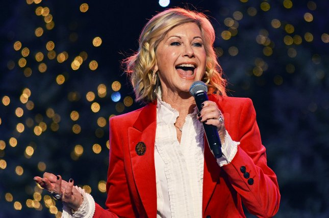 Olivia Newton-John spoke out in a new interview after doctors discovered a tumor in her lower back. File Photo by Christine Chew/UPI