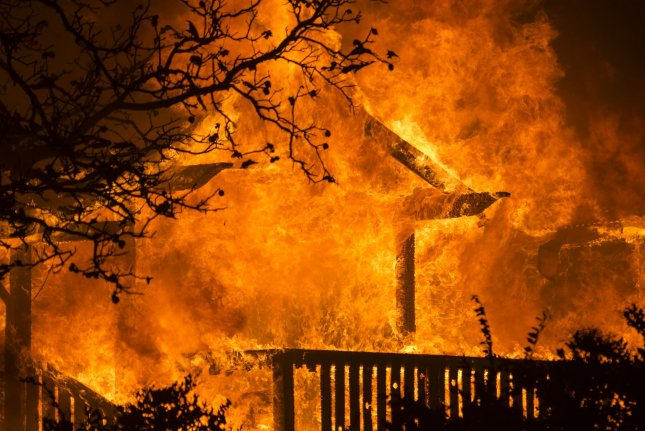 A building at Soda Rock Winery burns from wind driven embers in Healdsburg, California early Sunday, October 27, 2019. Over 200,000 people have been evacuated in Northern California as winds clocked as high as 93 MPH fanned flames. Photo by Terry Schmitt/UPI