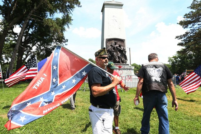 Steve Stepanek of St. Louis waves a Confederate flag at the Confederate Statue in Forest Park at a June 2017 rally in St. Louis. Photo by Bill Greenblatt/UPI